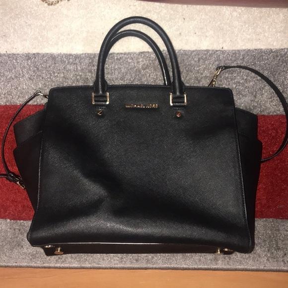 05b208c46b7a Black MK tote purse with gold accents. M 5b5e7f698869f748deadb51e